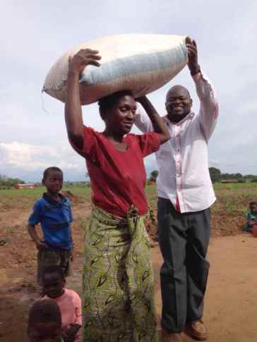 Maria is now receiving a bag of maize for her family.